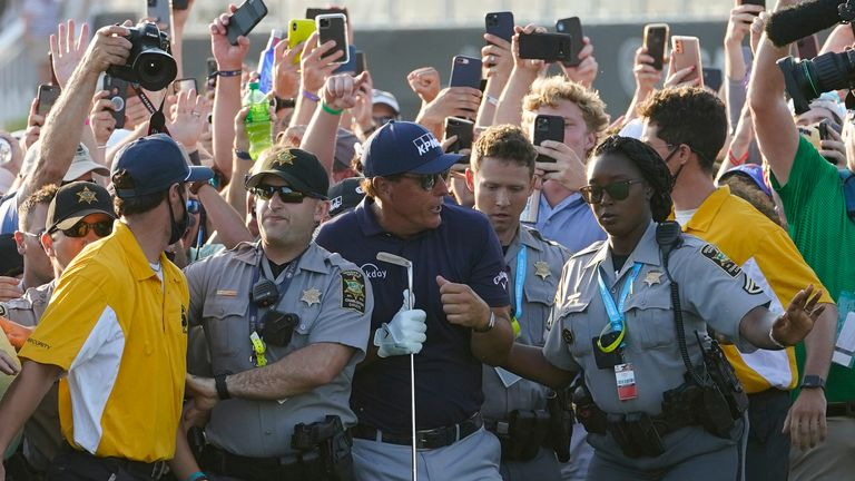 Phil Mickelson is swarmed by fans on the 18th fairway at Kiawah Island