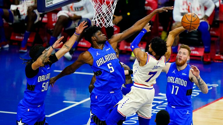 Philadelphia 76ers' Isaiah Joe (7) goes up for a shot against Orlando Magic's Mo Bamba (5), Ignas Brazdeikis (17) and Cole Anthony (50) during the second half of an NBA basketball game, Sunday, May 16, 2021, in Philadelphia. (AP Photo/Matt Slocum)