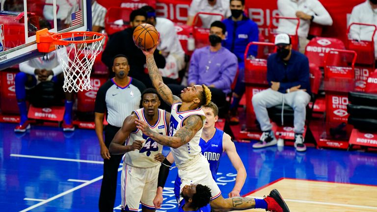 Philadelphia 76ers' Rayjon Tucker (9) goes up for a shot against Orlando Magic's Donta Hall (45) during the second half of an NBA basketball game, Sunday, May 16, 2021, in Philadelphia. (AP Photo/Matt Slocum)