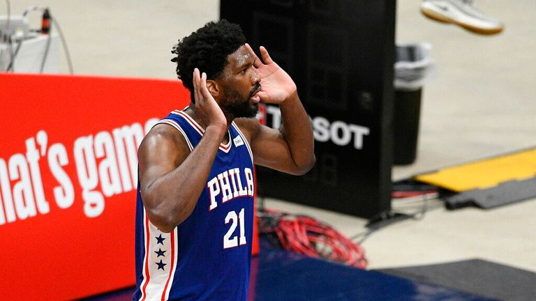 Philadelphia 76ers center Joel Embiid (21) gestures to the crowd after his dunk during the first half of Game 3 in a first-round NBA basketball playoff series against the Washington Wizards, Saturday, May 29, 2021, in Washington. (AP Photo/Nick Wass)
