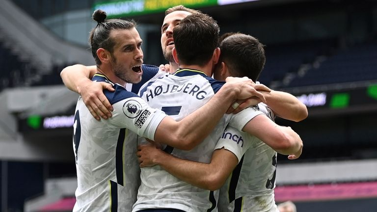 Pierre-Emile Hojbjerg celebrates with Spurs teammates after doubling their lead (AP)