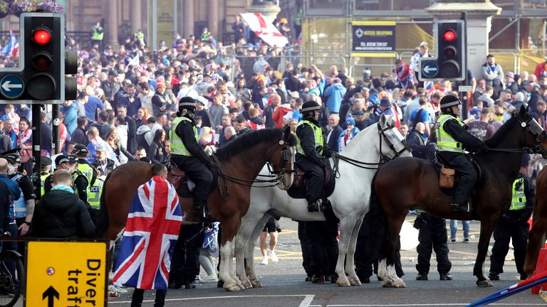 Mounted police watch on as Rangers fans celebrate winning the Scottish Premiership in George Square, Glasgow