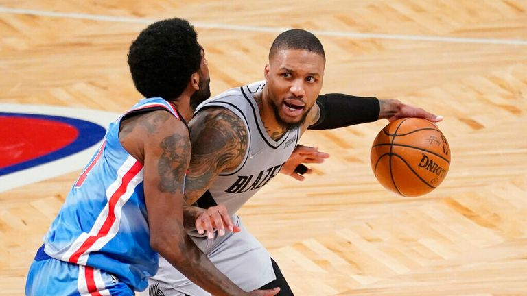 Portland Trail Blazers guard Damian Lillard, left, drives against Brooklyn Nets guard Kyrie Irving during the second half of an NBA basketball game, Friday, April 30, 2021, in New York. (AP Photo/Mary Altaffer)