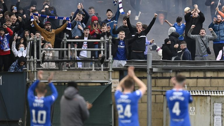 Rangers fans stood outside Livingston's stadium to watch the champions in action
