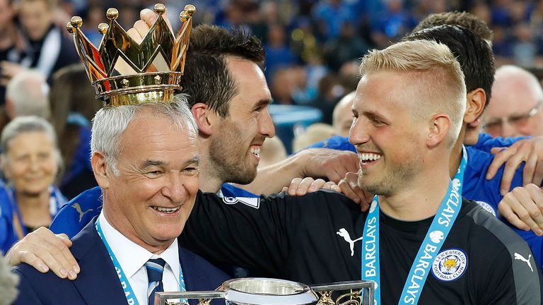 FILE - In this May 7, 2016 file photo, Leicester's team manager Claudio Ranieri gets a crown by Leicester's goalkeeper Kasper Schmeichel as they lift the trophy as Leicester City celebrate becoming the English Premier League soccer champions at King Power stadium in Leicester, England. Claudio Ranieri loves a challenge and his latest job at Sampdoria will be anything but straightforward. (AP Photo/Matt Dunham)