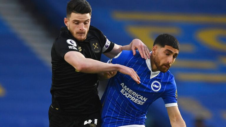 West Ham's Declan Rice, left, challenges for the ball with Brighton's Alireza Jahanbakhsh