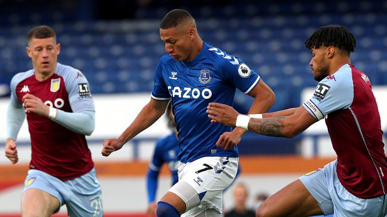 Richarlison looks to escape Tyrone Mings at Goodison Park