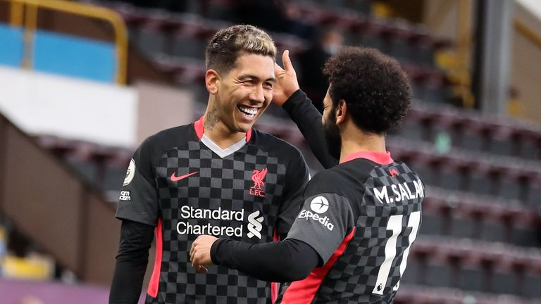 Roberto Firmino is congratulated by Mohamed Salah after scoring the opener
