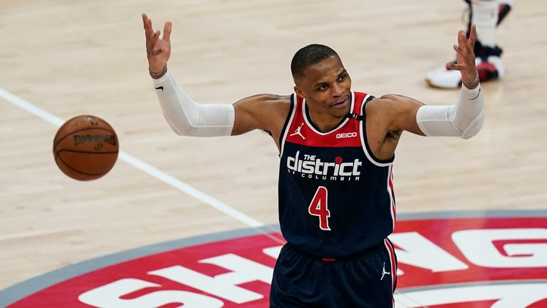 Washington Wizards guard Russell Westbrook reacts with the fans during a timeout