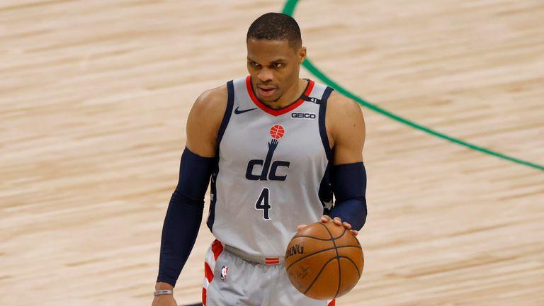 Washington Wizards guard Russell Westbrook handles the ball against the Dallas Mavericks