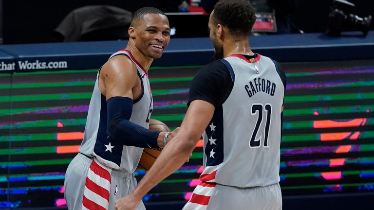Washington Wizards' Russell Westbrook, left, celebrates with Daniel Gafford following an NBA basketball game against the Indiana Pacers, Saturday, May 8, 2021, in Indianapolis. Washington won 133-132 in overtime.