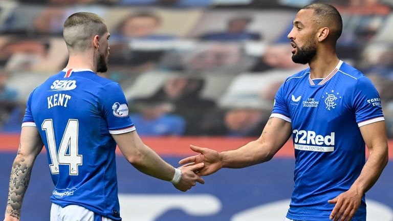 Kemar Roofe celebrates with Ryan Kent after making it 3-0 to Rangers against Aberdeen