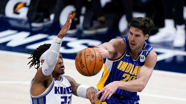 Indiana Pacers' Doug McDermott (20) passes the ball as ' Richaun Holmes (22) defends during the second half of an NBA basketball game Wednesday, May 5, 2021, in Indianapolis. (AP Photo/Darron Cummings)