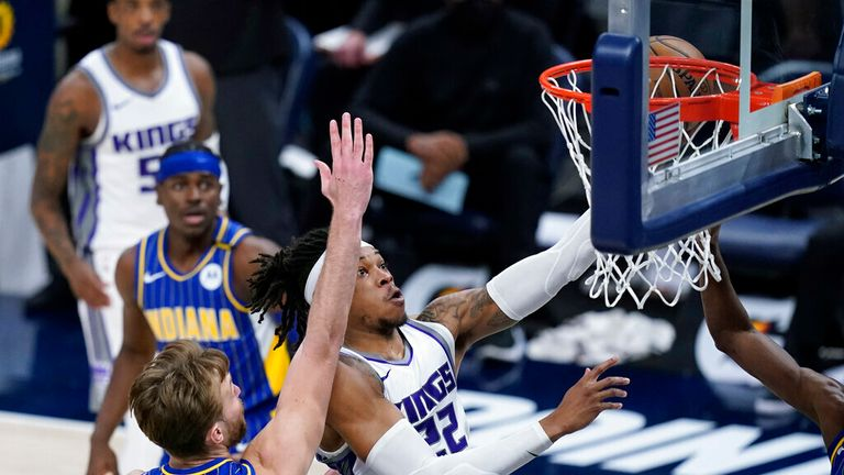 Sacramento Kings' Richaun Holmes (22) shoot against Indiana Pacers' Domantas Sabonis (11) during the first half of an NBA basketball game, Wednesday, May 5, 2021, in Indianapolis. (AP Photo/Darron Cummings)