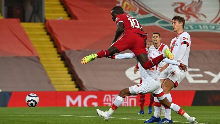 Sadio Mane rises to score Liverpool's opener at Anfield