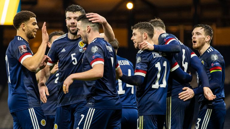 GLASGOW, SCOTLAND - MARCH 25: John McGinn celebrates after he makes it 2-2 with Che Adams (left) during a World Cup qualifier between Scotland and Austria at Hampden Park, on March 25, 2021, in Glasgow, Scotland. **Please note images are FREE for first use** (Photo by Alan Harvey / SNS Group)