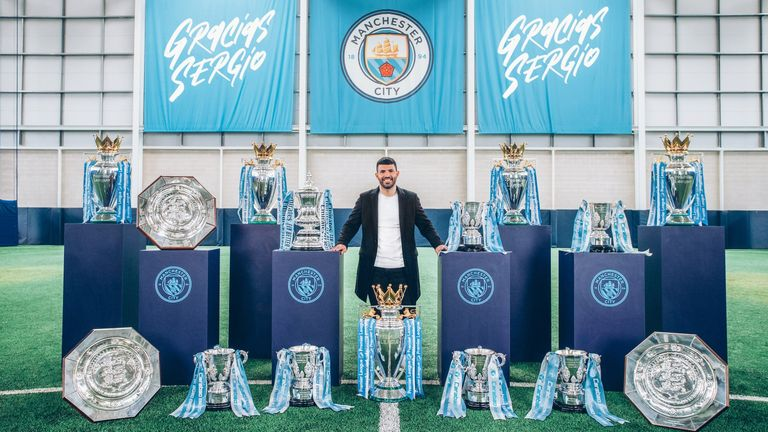 Sergio Aguero pictured with all 15 of the trophies he has won during his time at Manchester City