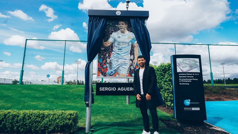 Sergio Aguero has been presented with a mosaic outside the Manchester City Football Academy inspired by his first goal for the club against Swansea City in 2011