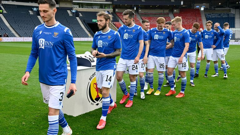 St Johnstone players collect their medals after the 2021 Scottish Cup final win over Hibernian at Hampden Park