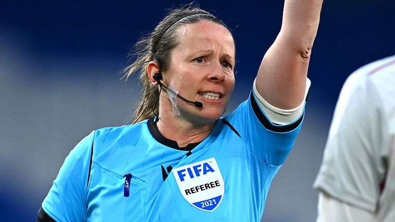 CARDIFF, WALES - APRIL 13: Referee, Stacey Pearson gives Nicoline Sorensen of Denmark a yellow card during the Women's International Friendly match between Wales and Denmark at Cardiff City Stadium on April 13, 2021 in Cardiff, Wales. Sporting stadiums around the UK remain under strict restrictions due to the Coronavirus Pandemic as Government social distancing laws prohibit fans inside venues resulting in games being played behind closed doors. (Photo by Dan Mullan/Getty Images)