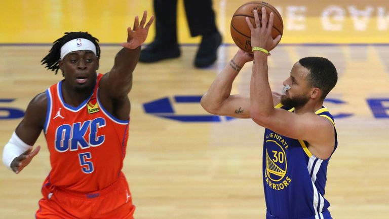 Golden State Warriors' Stephen Curry, right,  shoots a three point basket against Oklahoma City Thunder Luguentz Dort during the first half of an NBA basketball game in San Francisco, Saturday, May 8, 2021. (AP Photo/Jed Jacobsohn)