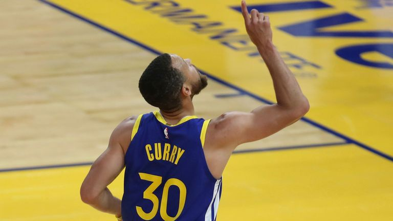 Golden State Warriors' Stephen Curry points to the sky after scoring against the Oklahoma City Thunder in the first half of an NBA basketball game in San Francisco on Saturday, May 8, 2021.
