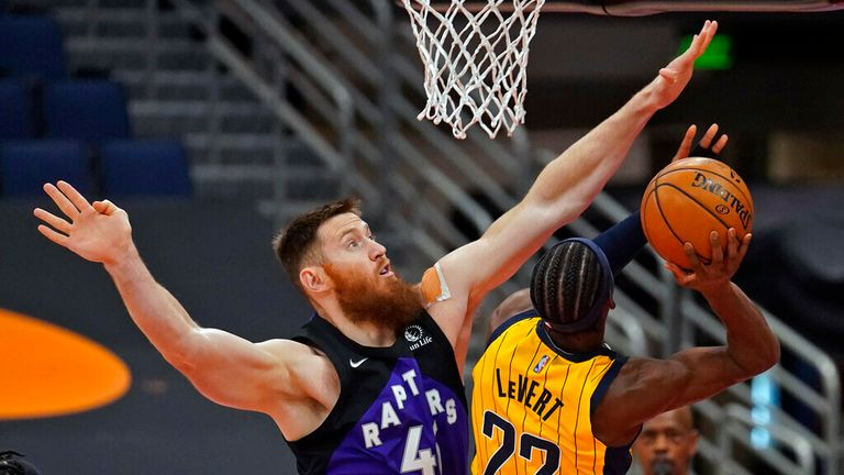 Toronto Raptors center Aron Baynes (46) goes up to blocka shot by Indiana Pacers guard Caris LeVert (22) during the first half of an NBA basketball game Sunday, May 16, 2021, in Tampa, Fla. (AP Photo/Chris O'Meara)