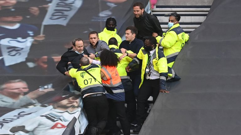 Tottenham supporters and stewards after Spurs' defeat to Aston Villa