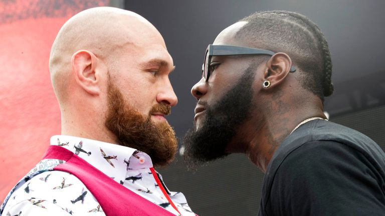 Tyson Fury, left, and Deontay Wilder face off, Tuesday, Oct. 2, 2018, during a news conference in New York ahead of their heavyweight world title showdown in Los Angeles on December 1. (AP Photo/Mary Altaffer)