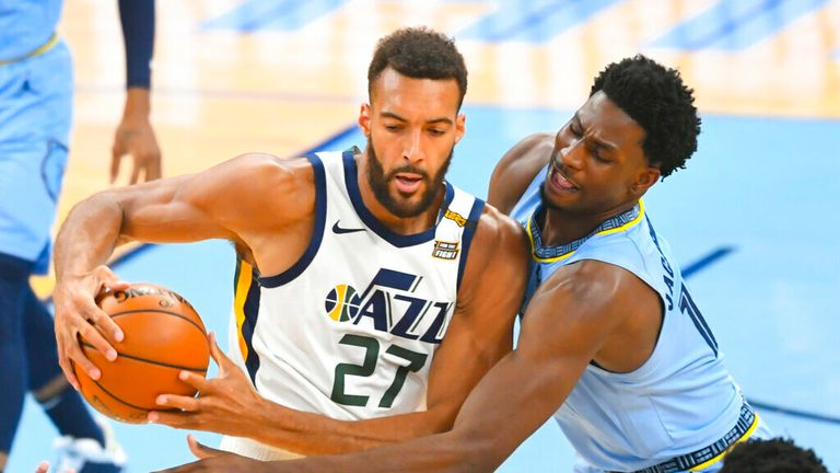 Utah Jazz center Rudy Gobert (27) tries to keep the ball from  forward Jaren Jackson Jr. during the first half of Game 3 of an NBA basketball first-round playoff series Saturday, May 29, 2021, in Memphis, Tenn. (AP Photo/John Amis)