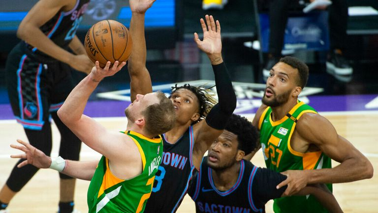Utah Jazz guard Joe Ingles, left, shoots against the Sacramento Kings during the second half of an NBA basketball game in Sacramento, Calif., Sunday, May 16, 2021. The Jazz won 121-99. (AP Photo/Randall Benton)