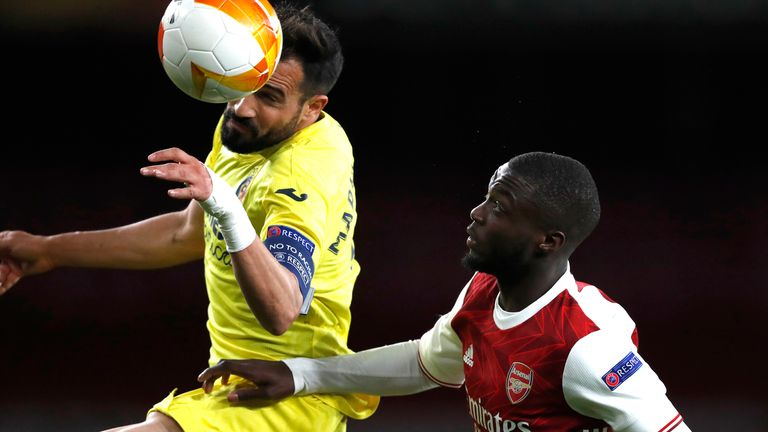 Villareal's Mario Gaspar, left, and Arsenal's Nicolas Pepe challenge for the ball during the Europa League semifinal second leg soccer match between Arsenal and Villarreal at the Emirates stadium in London, England, Thursday, May 6, 2021. (AP Photo/Alastair Grant)