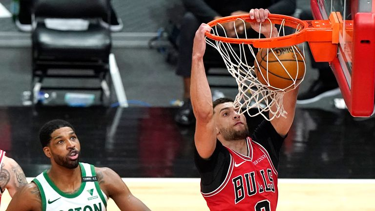 Chicago Bulls guard Zach LaVine dunks past Boston Celtics center Tristan Thompson
