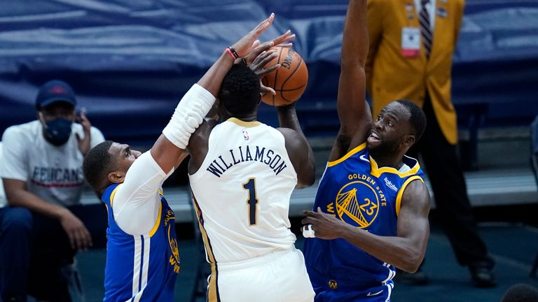 New Orleans Pelicans forward Zion Williamson is double teamed by Golden State Warriors forward Draymond Green and center Kevon Looney