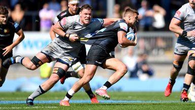 Henry Slade tries to break free from Cobus Wiese's tackle in Exeter's clash with Sale