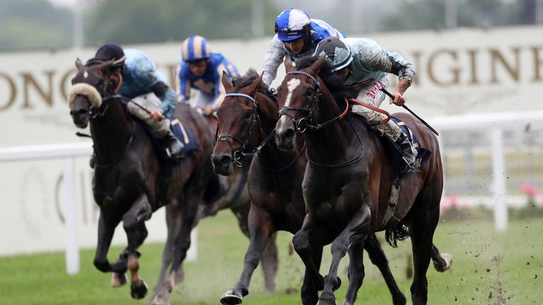 Alenquer ridden by Tom Marquand (right) wins the King Edward VII Stakes