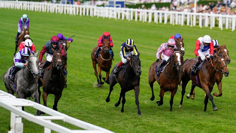 Laura Pearson riding Lola Showgirl (left) win the Kensington Palace Stakes