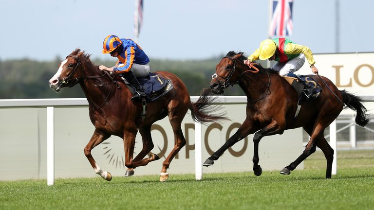 Love and Ryan Moore (left) coming home to win the Prince Of Wales's Stakes at Royal Ascot