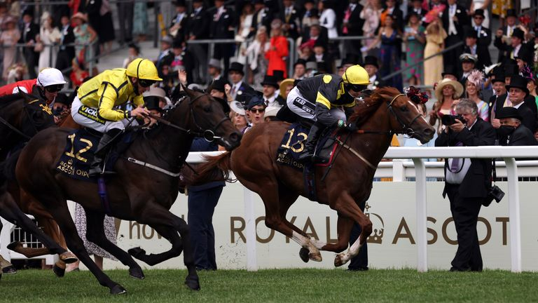 Perfect Power ridden by jockey Paul Hanagan (no.12) on their way to winning the Norfolk Stakes