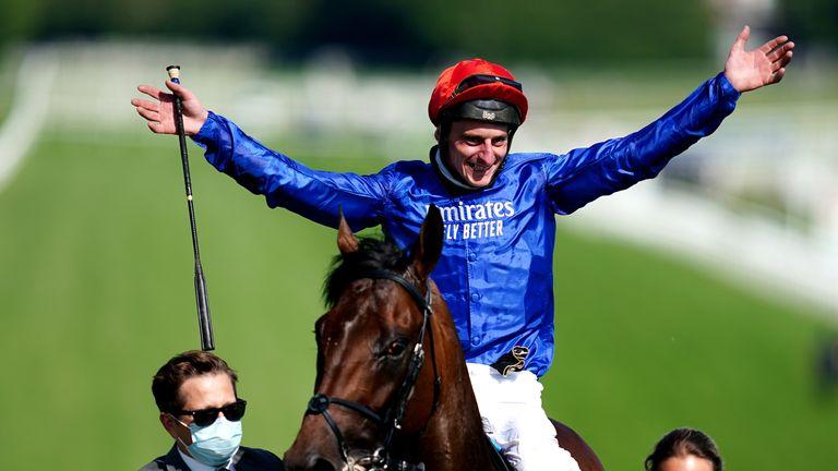 Adam Kirby celebrates victory in the Epsom Derby on board Adayar