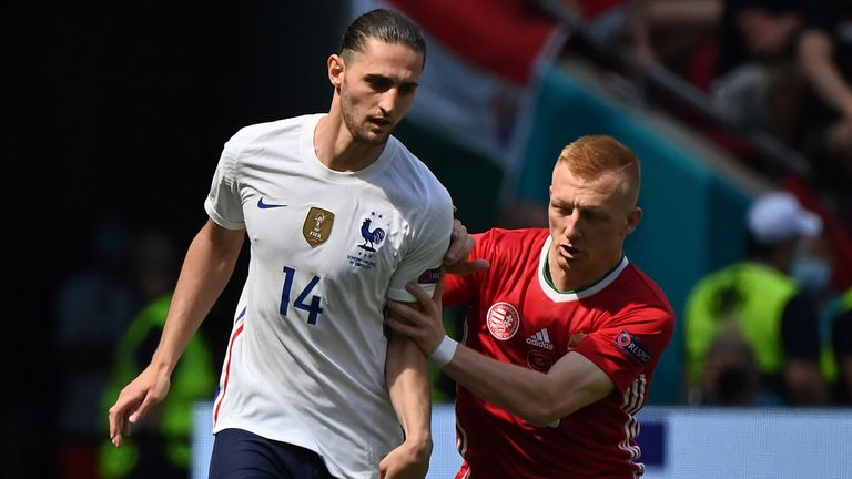 France's Adrien Rabiot is challenged by Hungary's Laszlo Kleinheisler