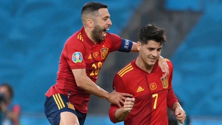 Alvaro Morata celebrates with Jordi Alba after scoring for Spain against Poland
