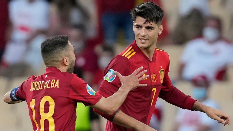 Alvaro Morata celebrates with Jordi Alba after scoring for Spain vs Poland