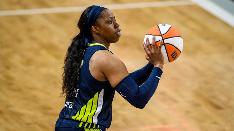 Dallas Wings guard Arike Ogunbowale shoots during a WNBA basketball game against the Atlanta Dream