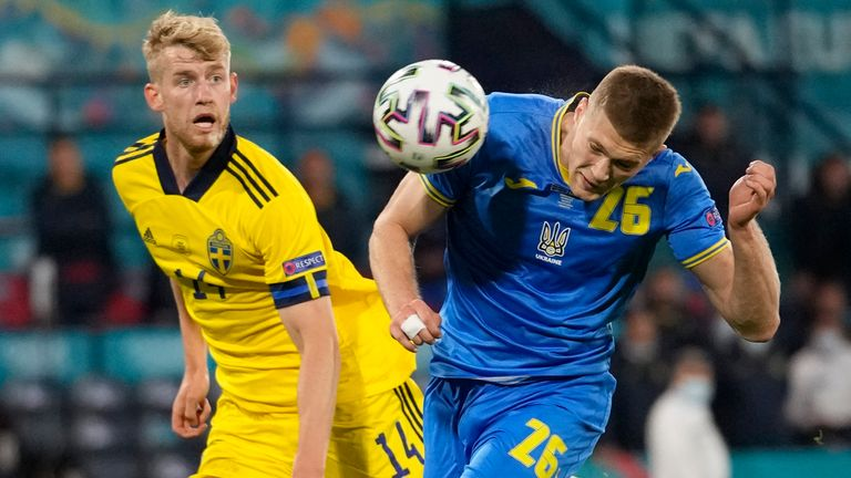 Ukraine's Artem Dovbyk scores his side's second goal during the Euro 2020 soccer championship round of 16 match between Sweden and Ukraine at the Hampden Park