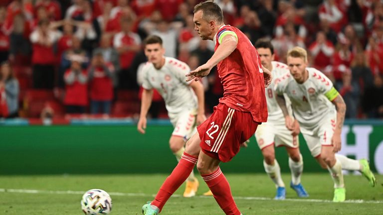 Russia's Artem Dzyuba scores his side's opening goal from a penalty shot during the Euro 2020 soccer championship group B match between Russia and Denmark