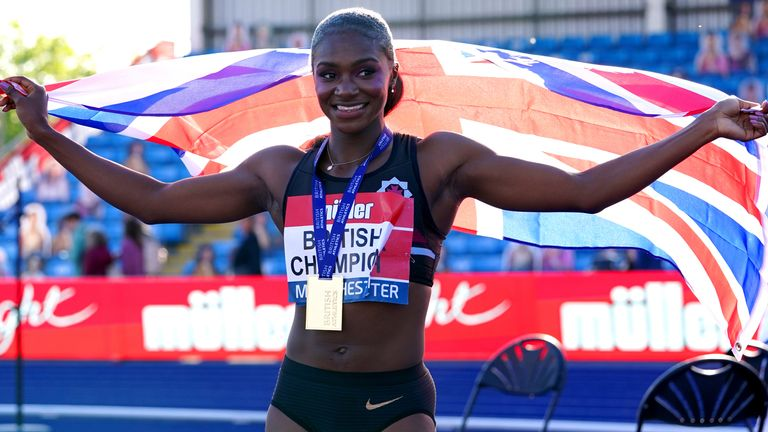 Dina Asher-Smith celebrates after winning the Women's 100 metre final during day two of the Muller British Athletics Championships