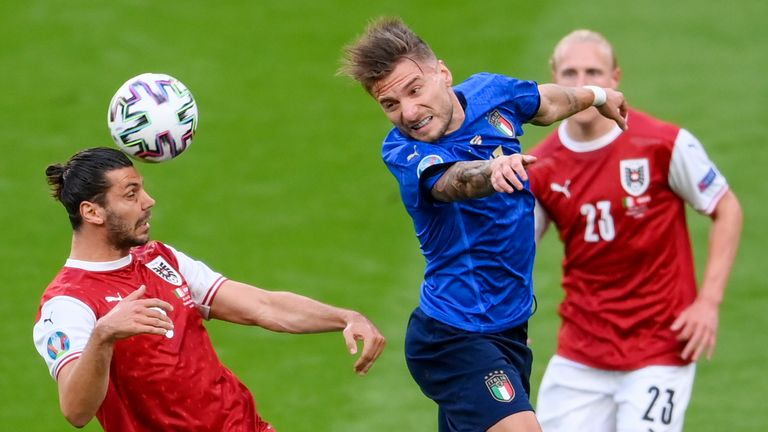 Austria's Aleksandar Dragovic, left, and Italy's Ciro Immobile compete to head the ball during the Euro 2020 soccer championship round of 16 match between Italy and Austria at Wembley Stadium, London, Saturday, June 26, 2021. (Laurence Griffiths/Pool Photo via AP)