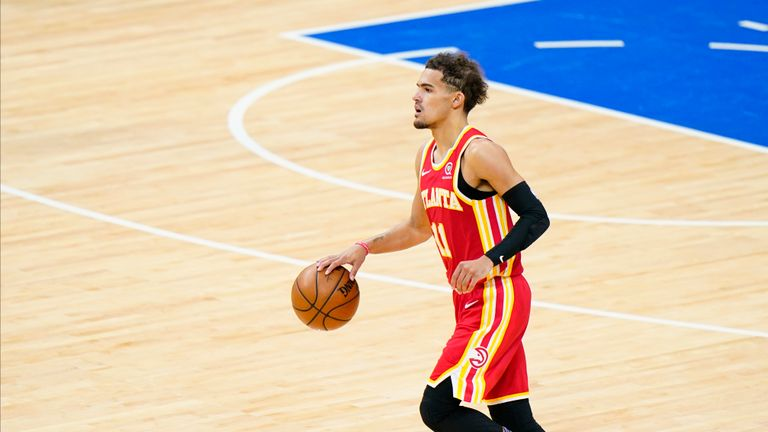 Atlanta star Trae Young made the assist for Clint Capela's spectacular alley-oop dunk as the Hawks reduced Philadelphia's second quarter lead.