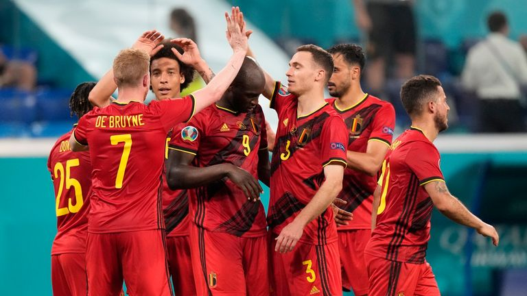 Belgium players celebrate the opening goal of their team during the Euro 2020 soccer championship group B match between Finland and Belgium